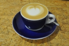 My decaf cappuccino, served in a classic blue cup with white trim.