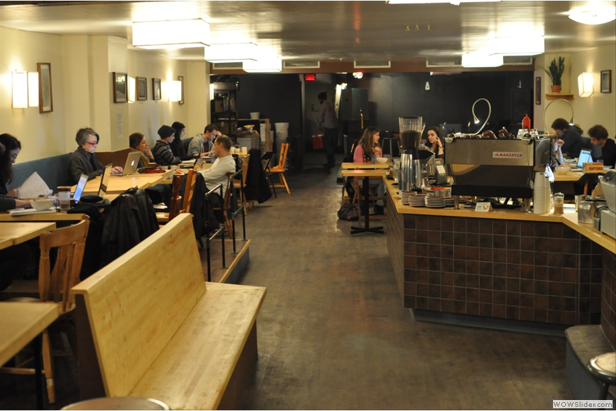 Stepping inside, it is surprisingly spacious. Beyond the seating at the windows and some tables out of shot to the left, the main seating stretches away from you. The counter is to the right with the stage for the muscians right at the back.