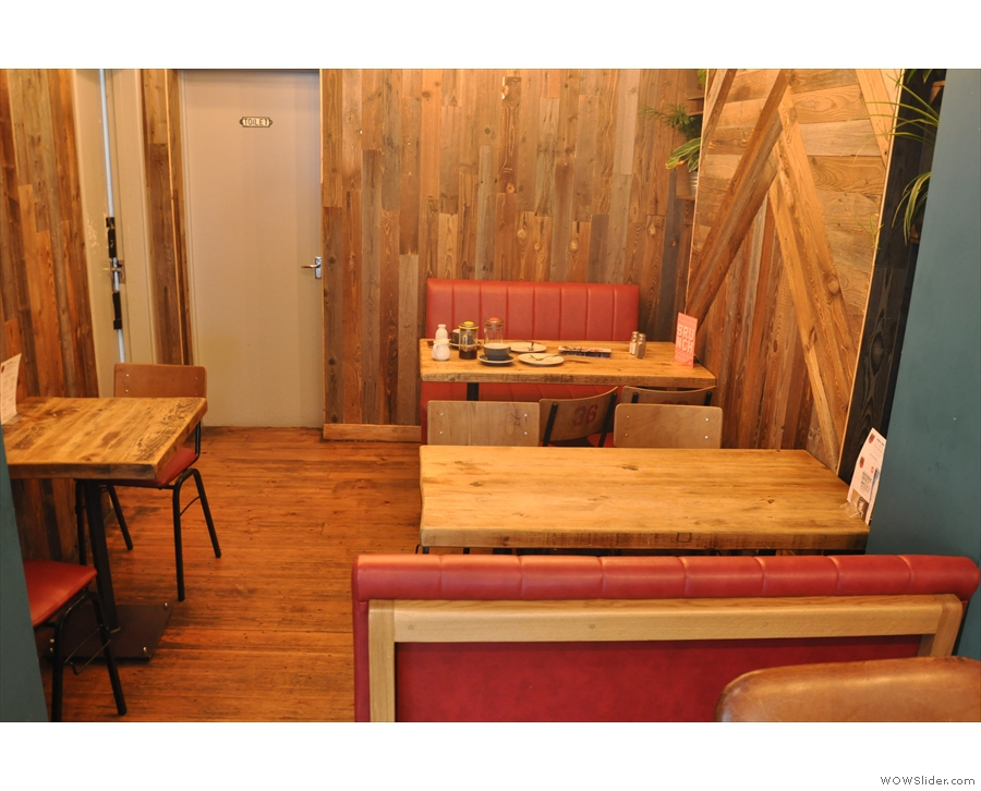 Beyond that, the space narrows into this alcove, with two four-person tables on the right...