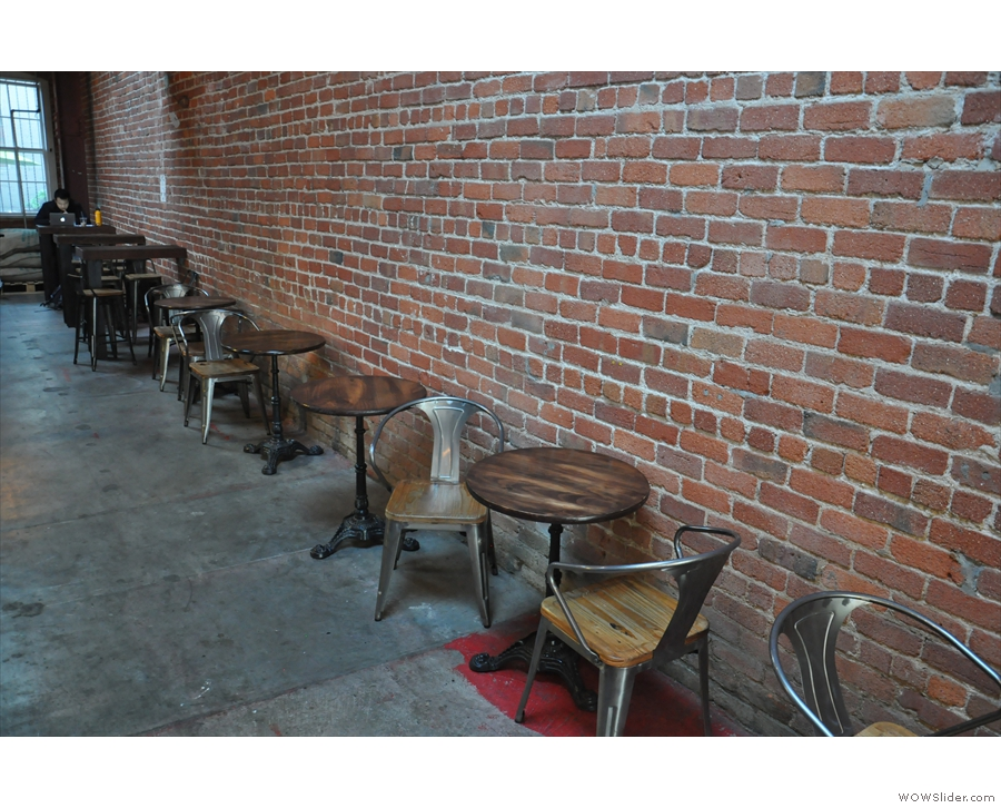... followed by a long row of two-person tables against the right-hand wall.
