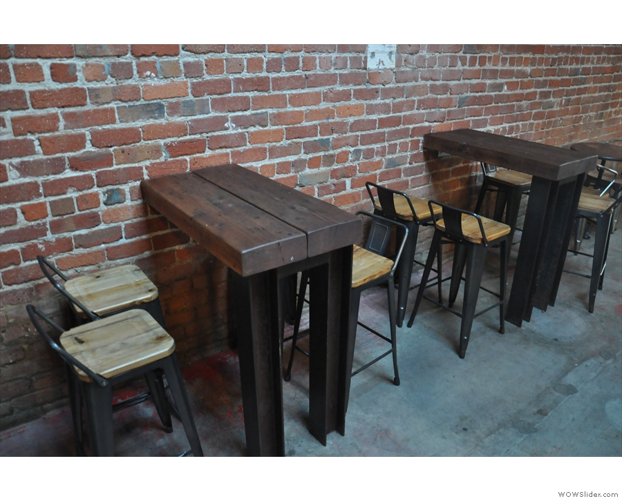 Opposite this, on the right, are three of these high, four-person tables.