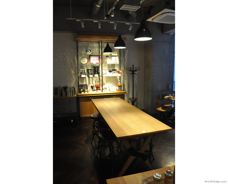 Beyond the retail area, there's seating in the form of this communal table...