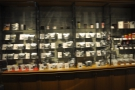 ... and rows of shelves on the walls, full of bags of coffee.