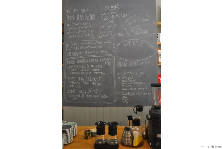 The beans are described on the blackboard behind the brew bar.
