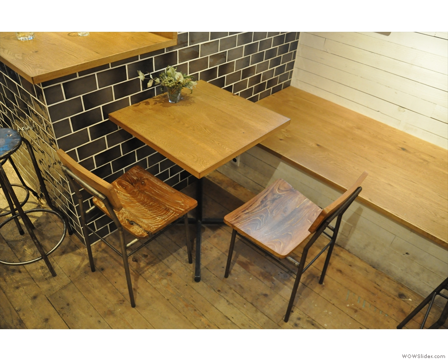Alternatively, there's more seating beyond the counter, starting with this table on the left.