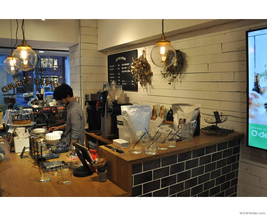 The counter is at the front of the shop, on the left as you enter.