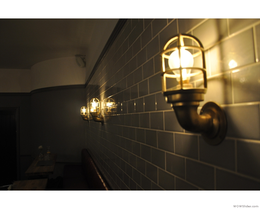 Not to be outdone, the tiled wall on the right has some fantastic light fittings as well.