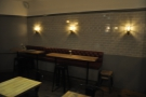 As well as the tables in the middle of the room, there are padded benches along the walls.