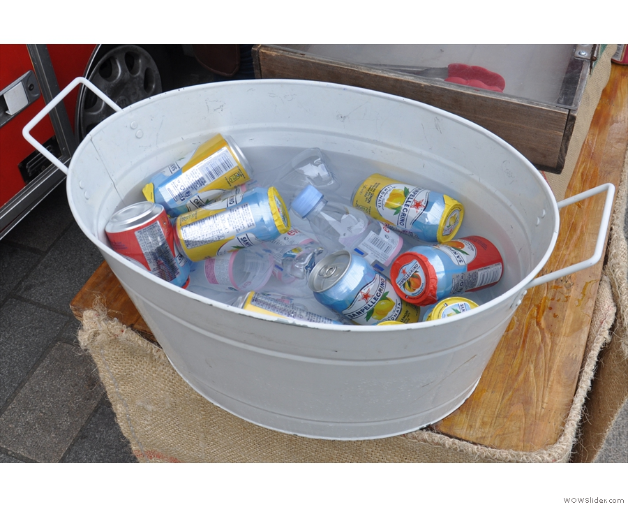 There are also soft drinks, kept cold in this tub of iced water.