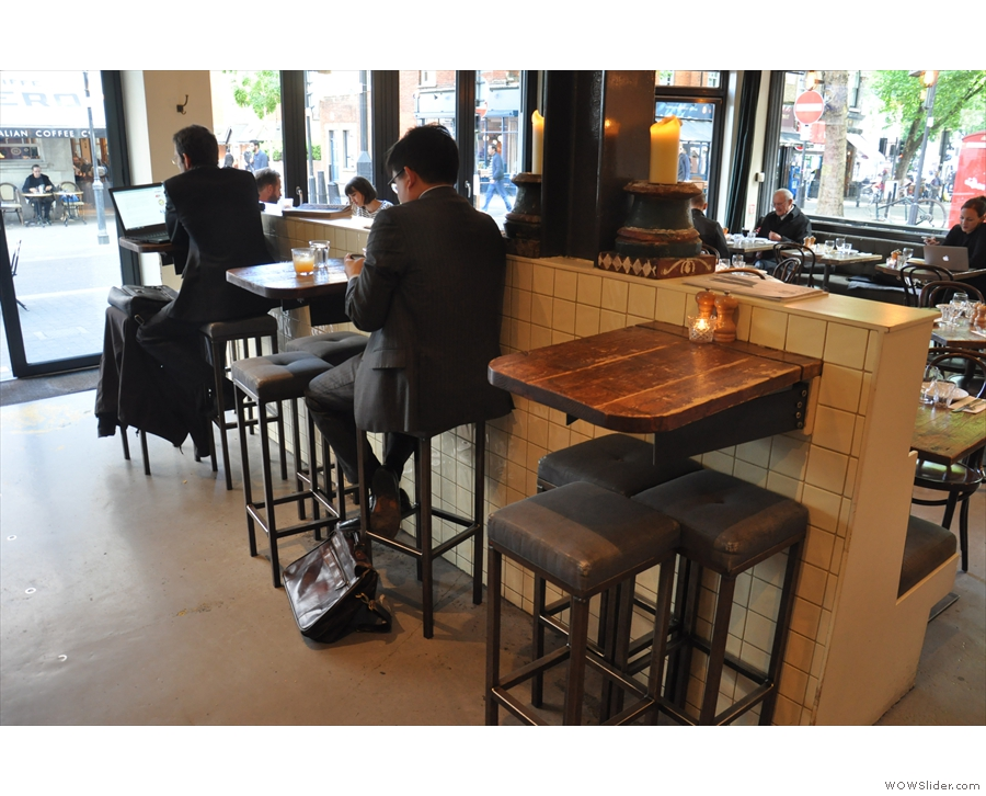 You can sit at the counter itself, or at one of these three high tables.