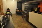 However, right at the back, the counter ends and there's more seating. With chairs!