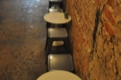 Another view of the seating opposite the counter.