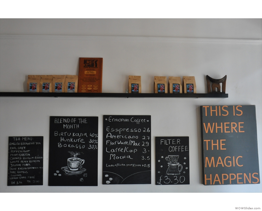 The menus and some bags of coffee are, unusually, on the wall off to the right.
