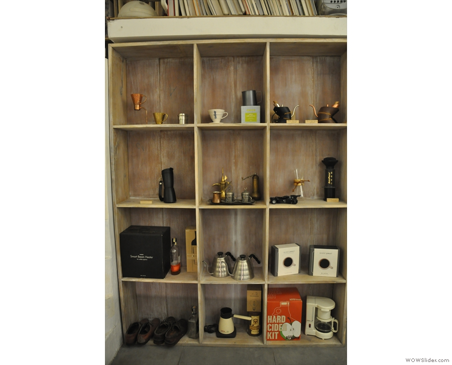 A display of coffee-making kit from the shelves at the back.