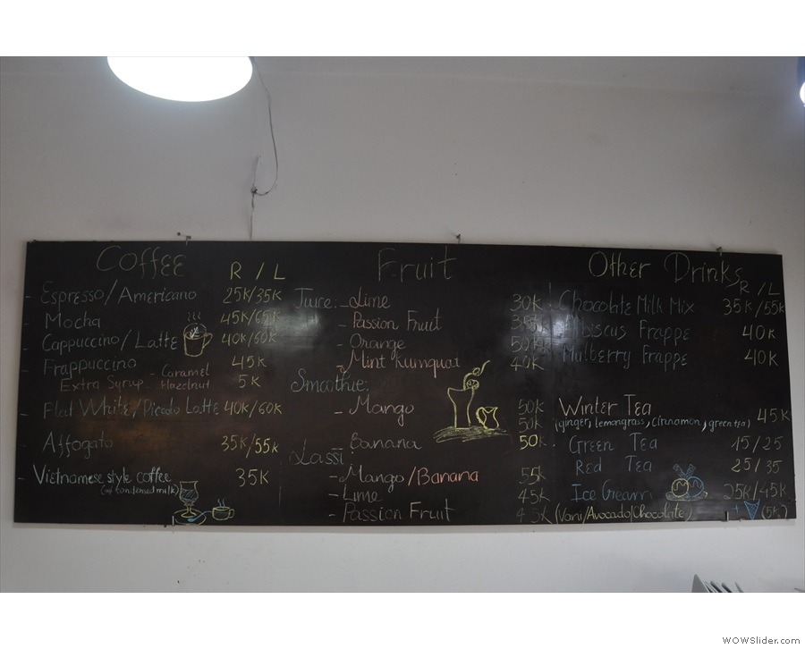 If you want to drink some coffee (or tea), the menu's on the wall behind the counter.