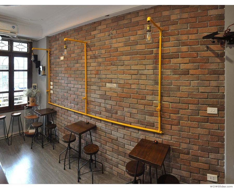 There are three more two-person tables against the right-hand wall. Nice lights too!
