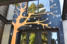 ... with a neat, painted tree which goes all the way to the top of the building.
