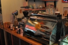 In the middle, between the two grinders, is the Victoria Arduino lever espresso machine...