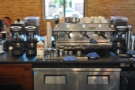 The espresso machine & its grinders, seen from the front of the counter.