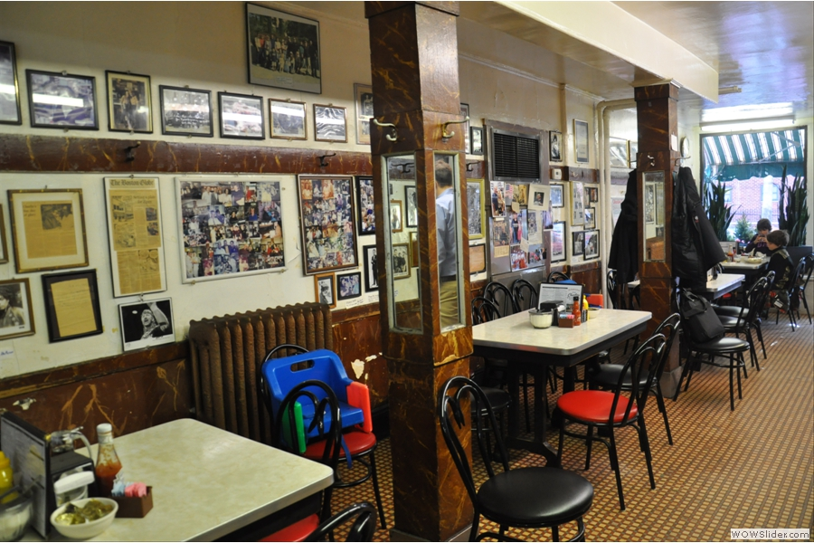 The walls are adorned with pictures of famous patrons from over the years.