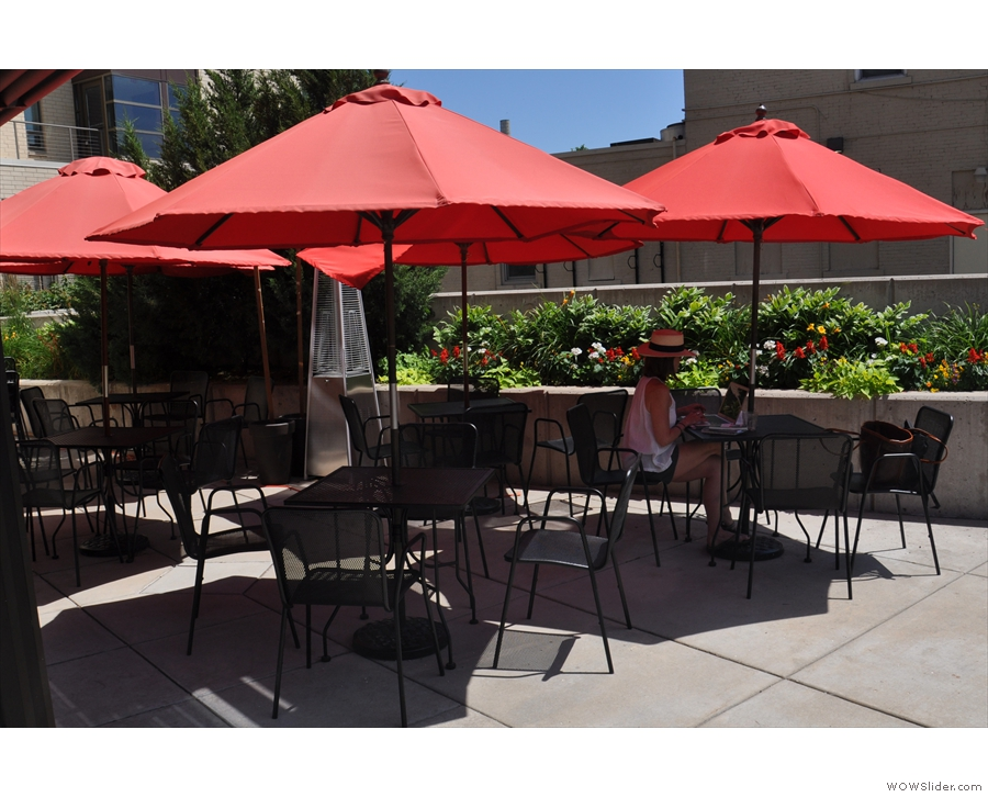 ... while off to the right is an outdoor seating area with a handful of shaded tables.