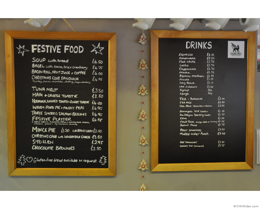 The menus are on the wall behind the counter: food (left) and drinks (right).