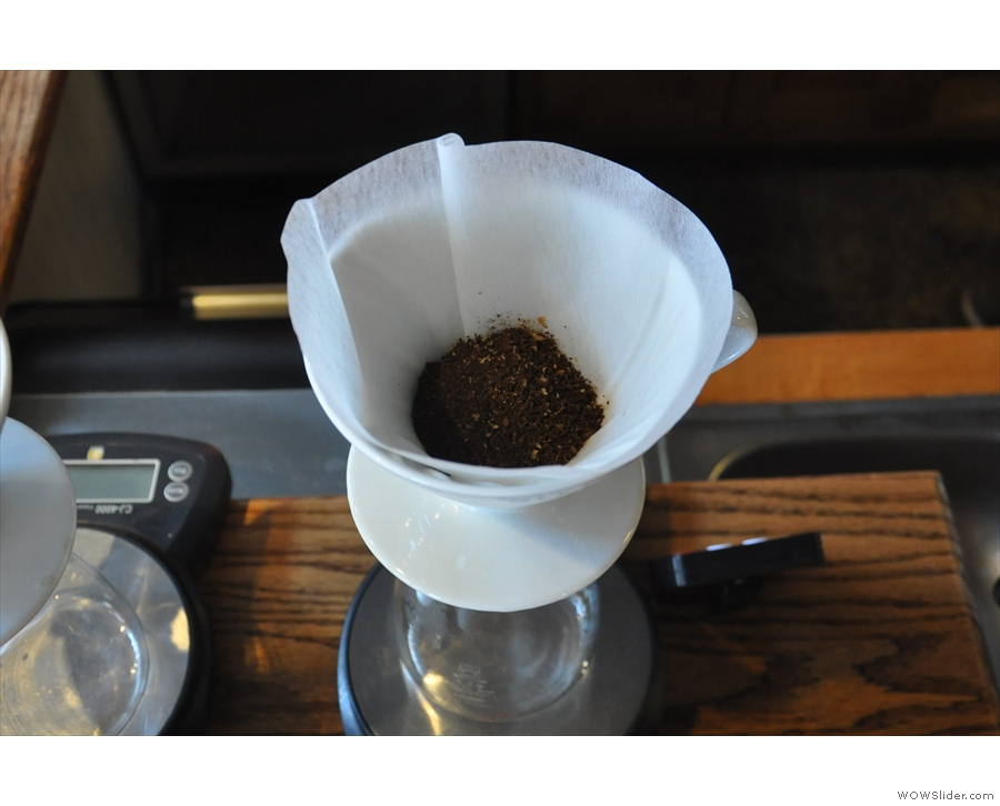 The ground coffee is emptied into a pre-rinsed filter paper...