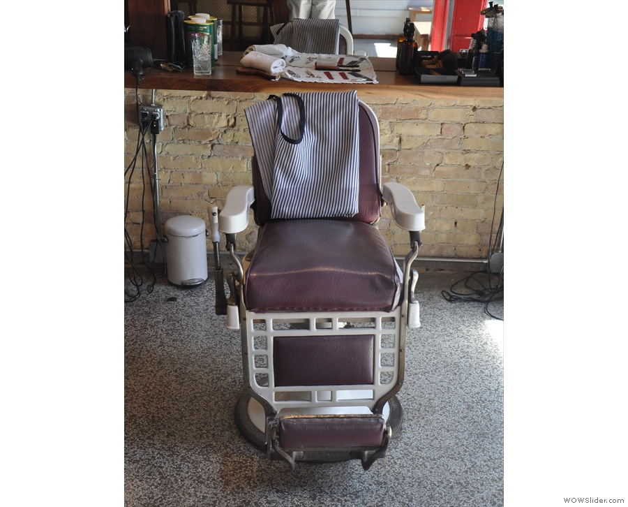 A barber's chair in detail. Sadly you need to book a haircut before you can sit in one.