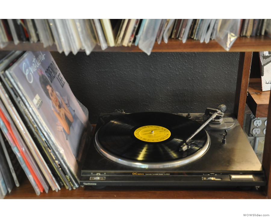 ... while, in the corner, there's a vinyl turntable and a stack of LPs.