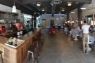 The view from just inside the door, with the barbershop (right) and the coffee bar (left).