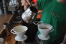 ... in a single pour, the kettle being moved around the surface of coffee. No stirring here.