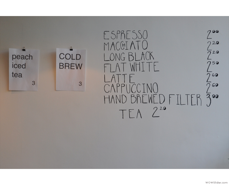 The coffee menu, which is commendably concise, is on the wal lbehind the counter.