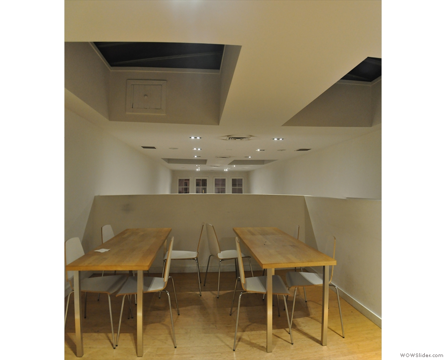 There's space for two four-person tables (with chairs!). Check out the skylights.