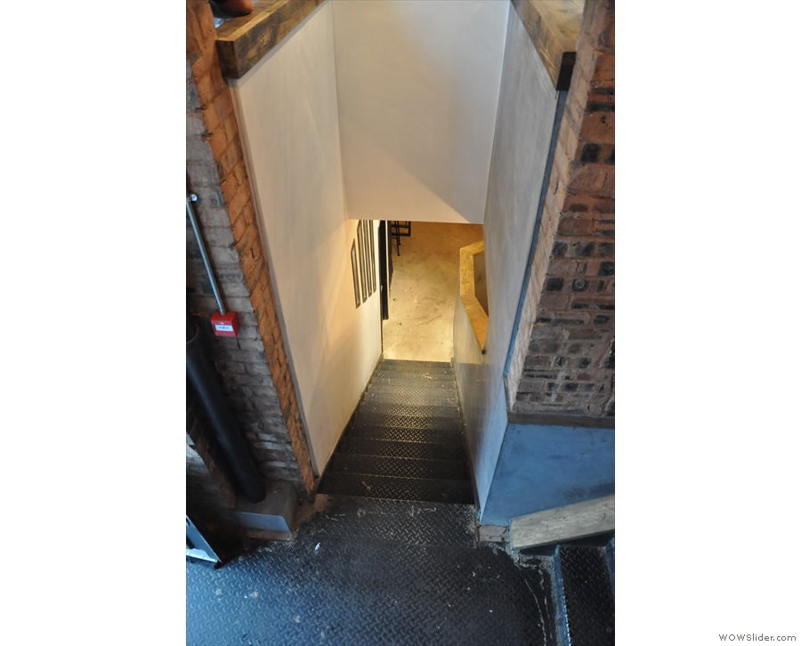 Going down the steps, on your right, you'll find these: more steps, down to the basement!