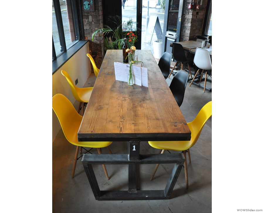 There's plenty of seating in the front, such as this communal table on the right...