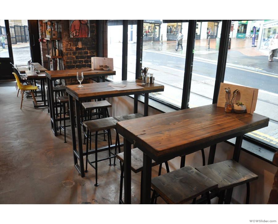 ... where you'll find these high tables opposite the counter.