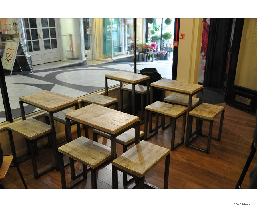 ... while the tables in the window, which used to be very regimented in their spacing...