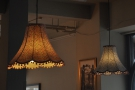 There are the usual exposed light bulbs, but also some proper lampshades...