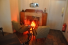Right at the back is the trademark 200 Degrees neon fireplace with two armchairs...