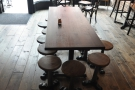 ... while there's also this long, communal table with stools.