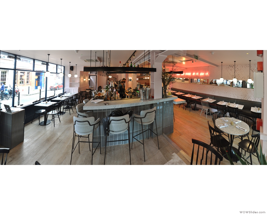 A panoramic view of Exmouth Market from the front, with seating down either side.