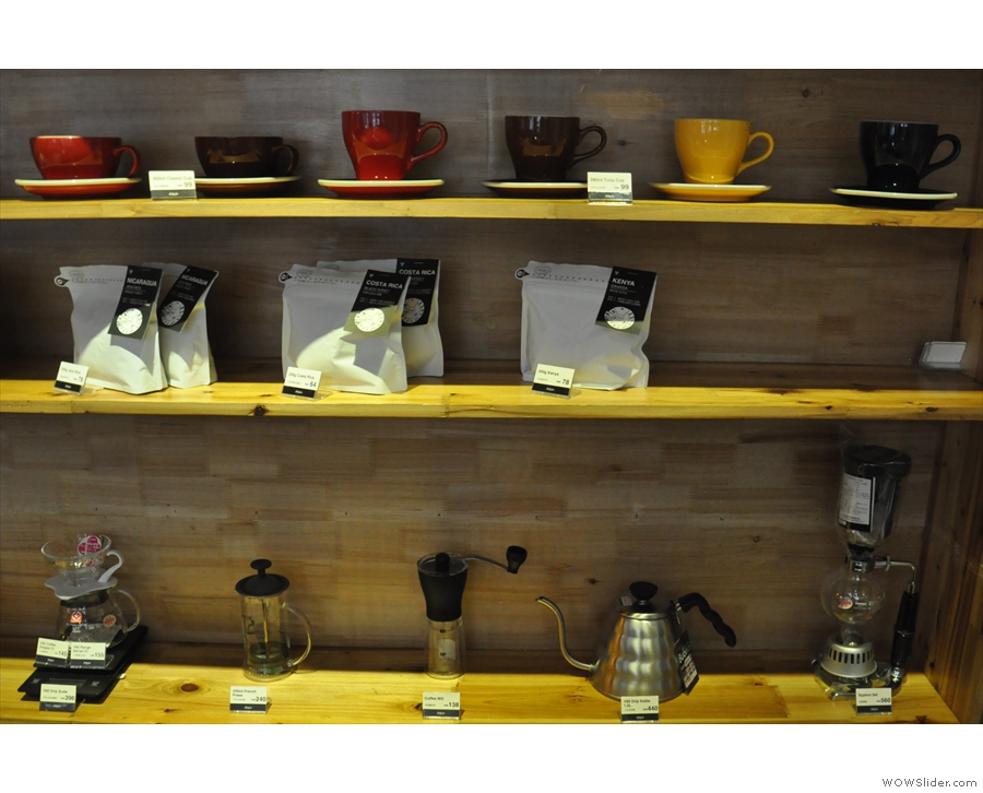 The retail shelves have all the usuals: cups, coffee and coffee-making kit.