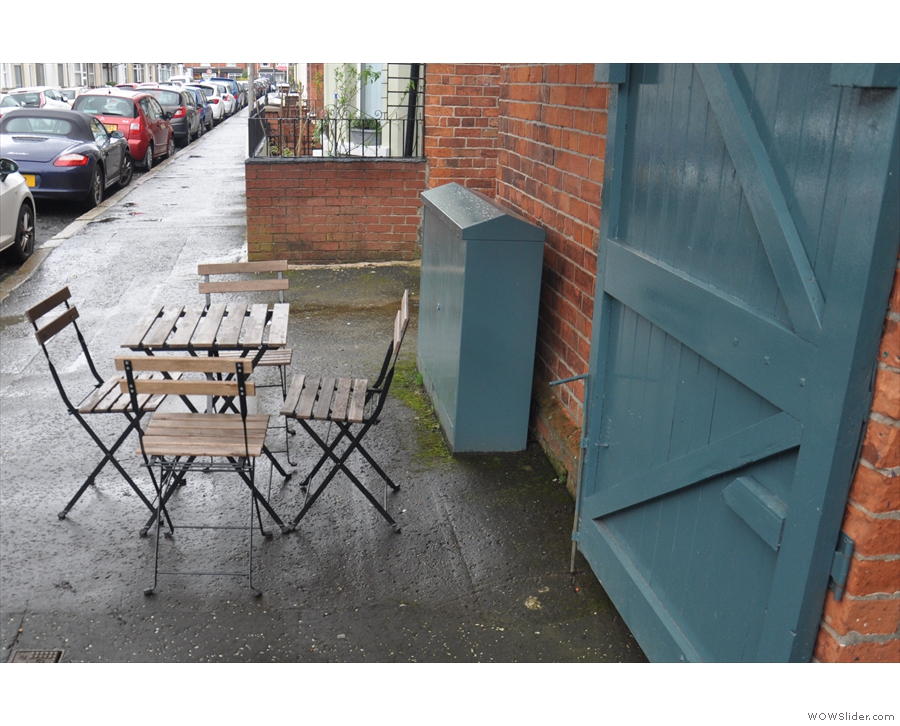When not pouring with rain, the outside seating is a good option. There's a table here...