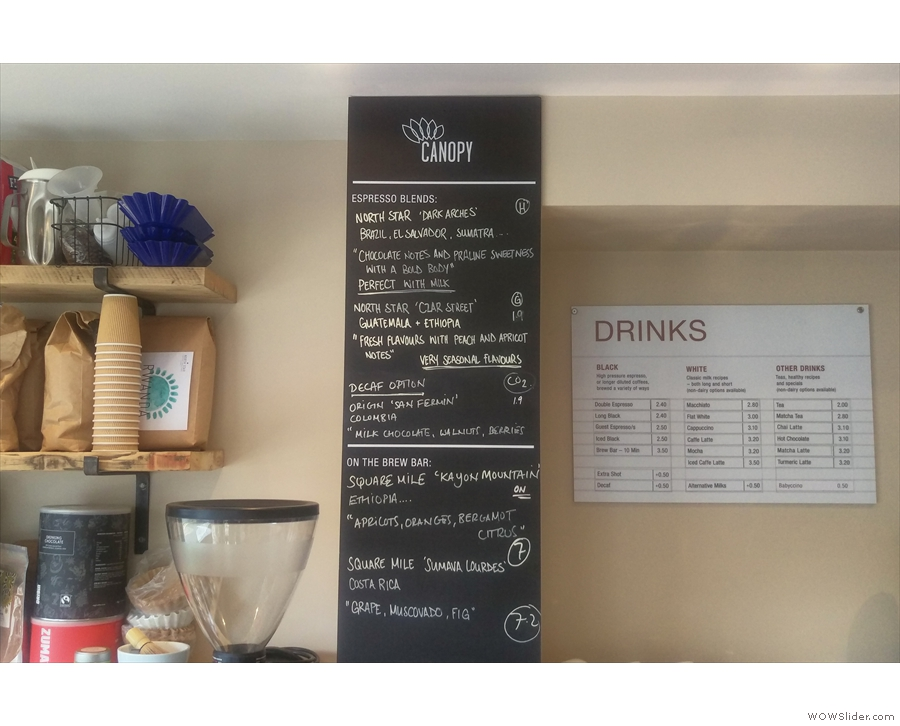 The coffee menus are conveniently on the wall behind the till, to your left as you enter.