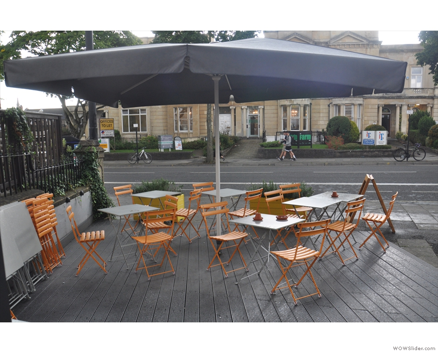 ... the tables were huddled under the umbrella, as seen here, looking towards the road.