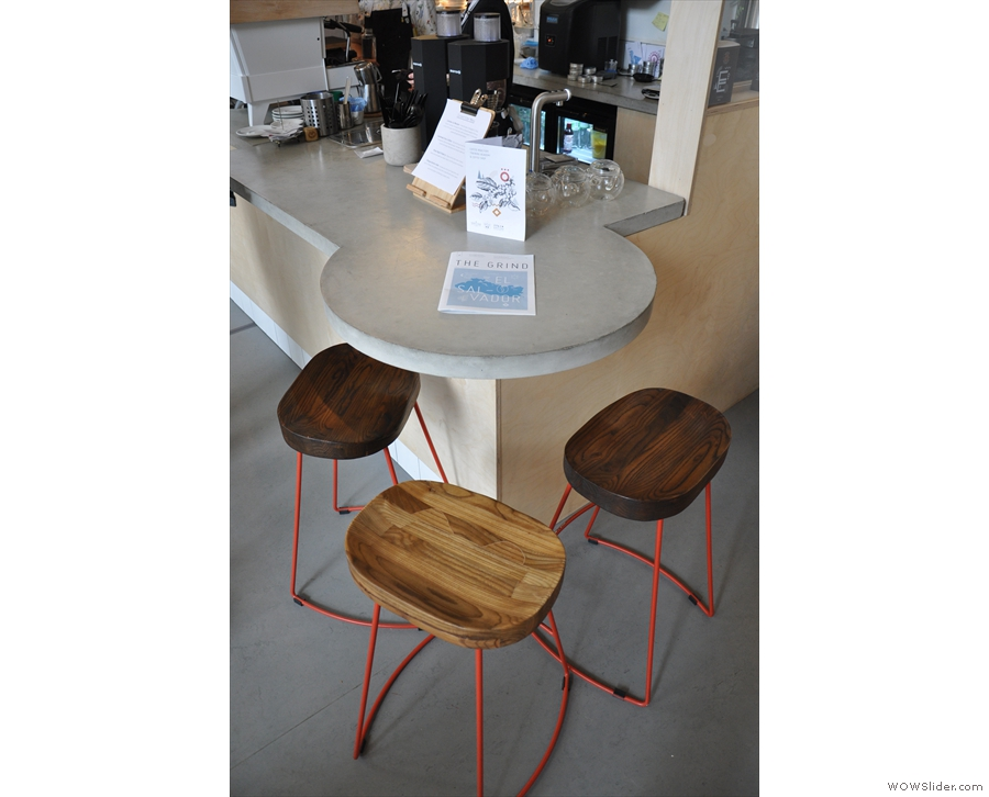 There's one more seating area, three bar stools around a circular bit at the counter's end.
