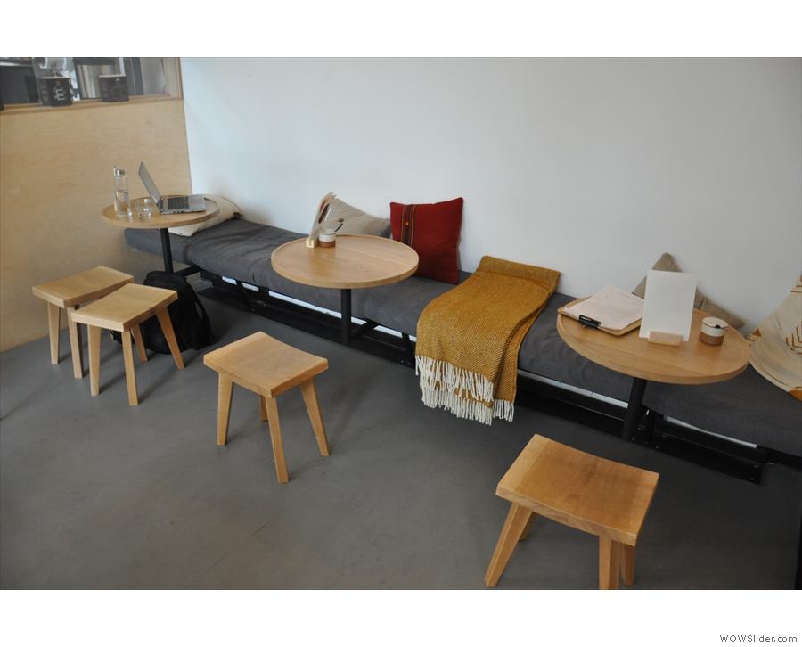 ... and three small, round tables, which project from the bench.
