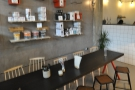 ... while further on, down past the counter on the left, is this long, communal table...