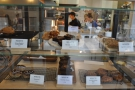 There are cakes in the glass display case to the left...