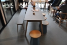 There's a bench for seating on the far side, with low stools for the rest.